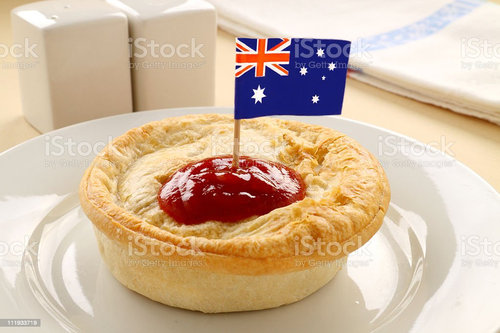 Meat pie with catchup and the Australian flag on top stock photo