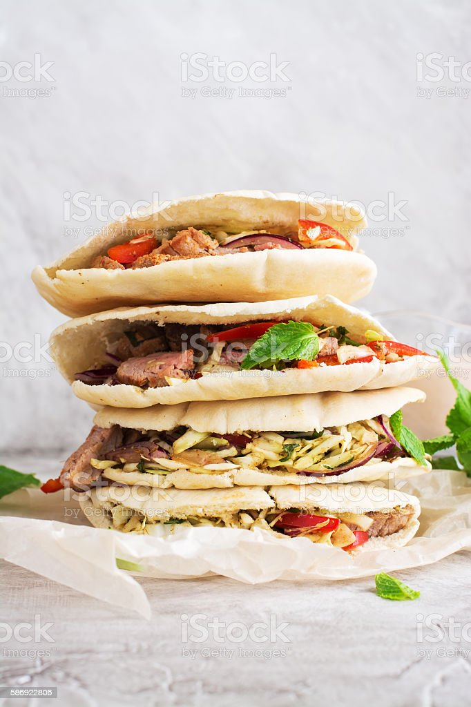 Meat pita bread with yogurt sauce and mint leaves stock photo