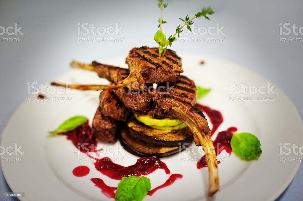 meat ribs with eggplant isolated on white stock photo