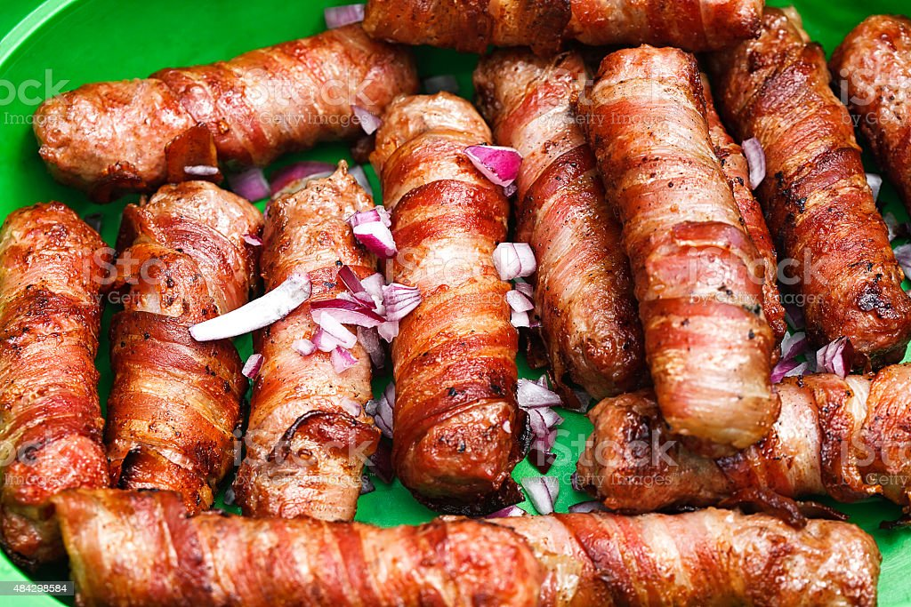 meat rolled with bacon stock photo