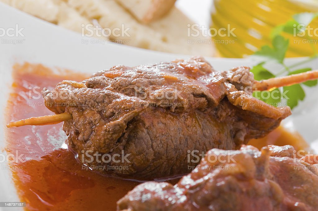 Meat roulade on white dish. royalty-free stock photo