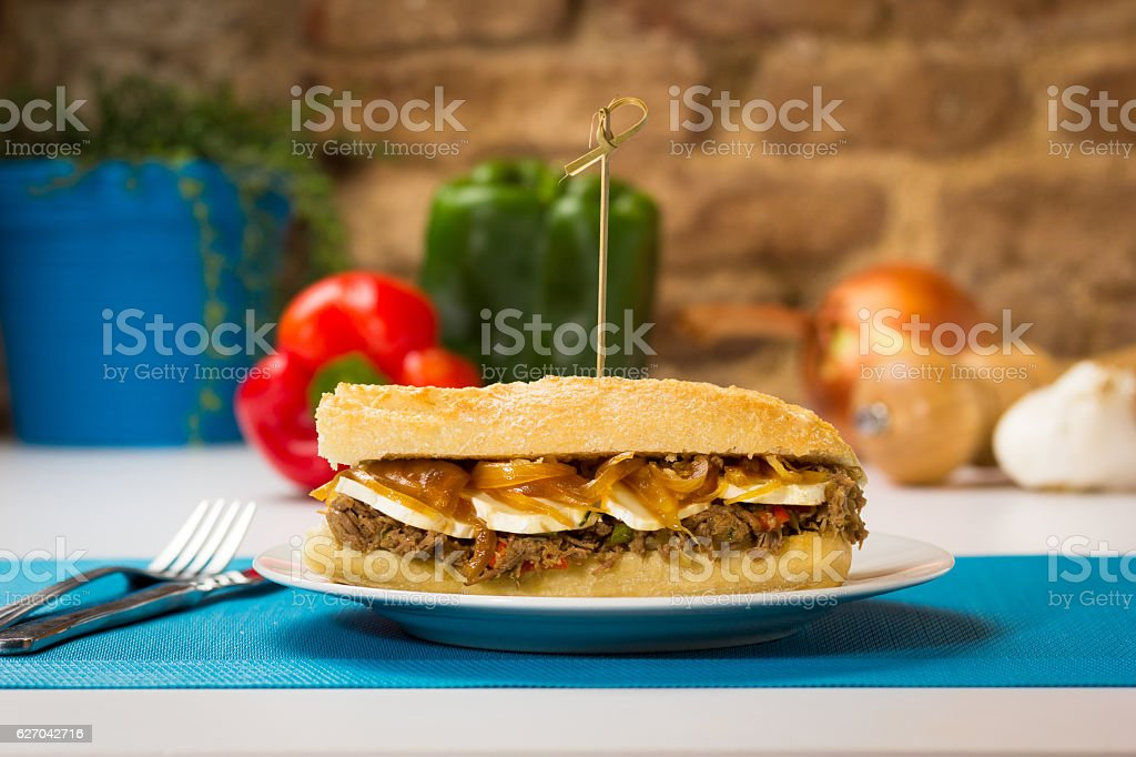 Meat sandwich with sweet onion and goat cheese stock photo