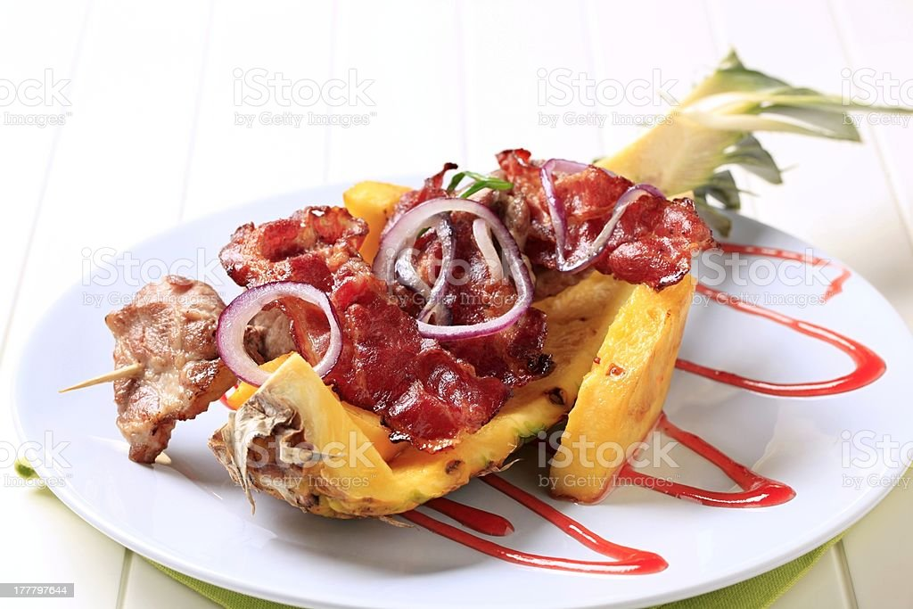 Meat skewers and crispy bacon strips royalty-free stock photo