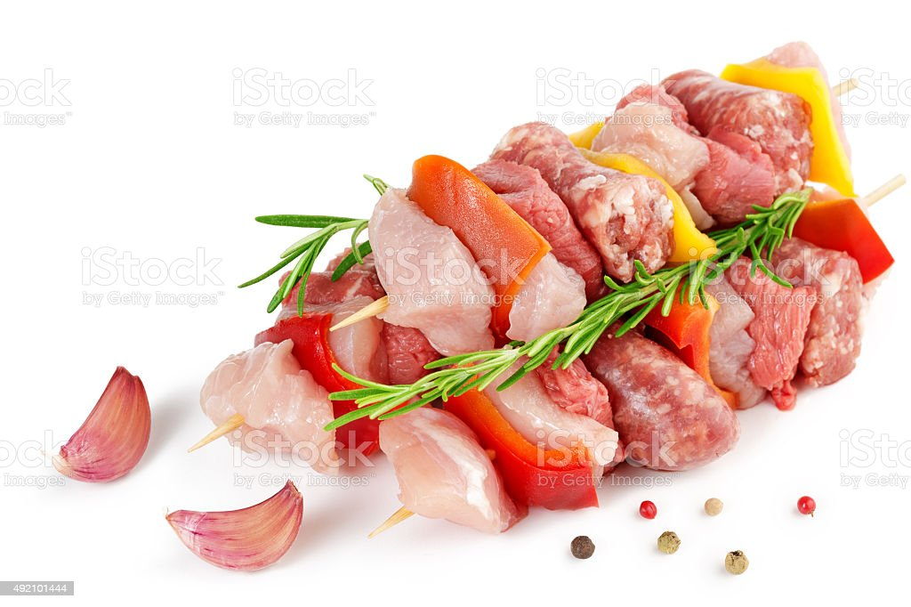 meat skewers, garlic and peppercorns stock photo