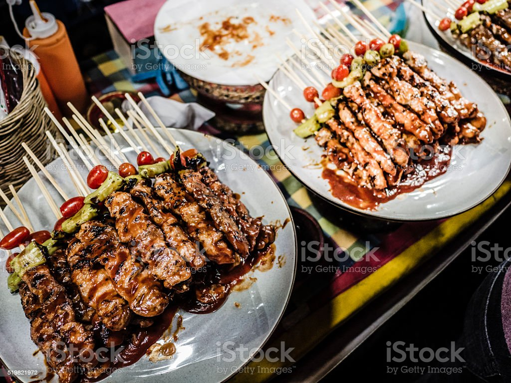 Meat skewers in street market stall Bangkok Thailand stock photo