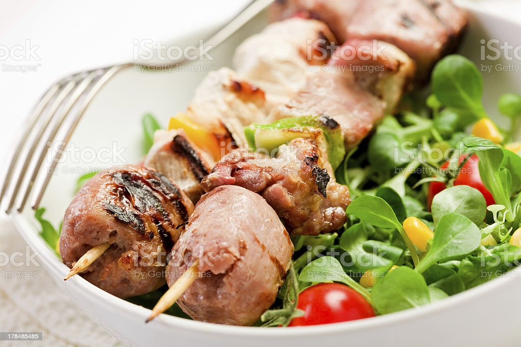Meat Skewers on white table royalty-free stock photo