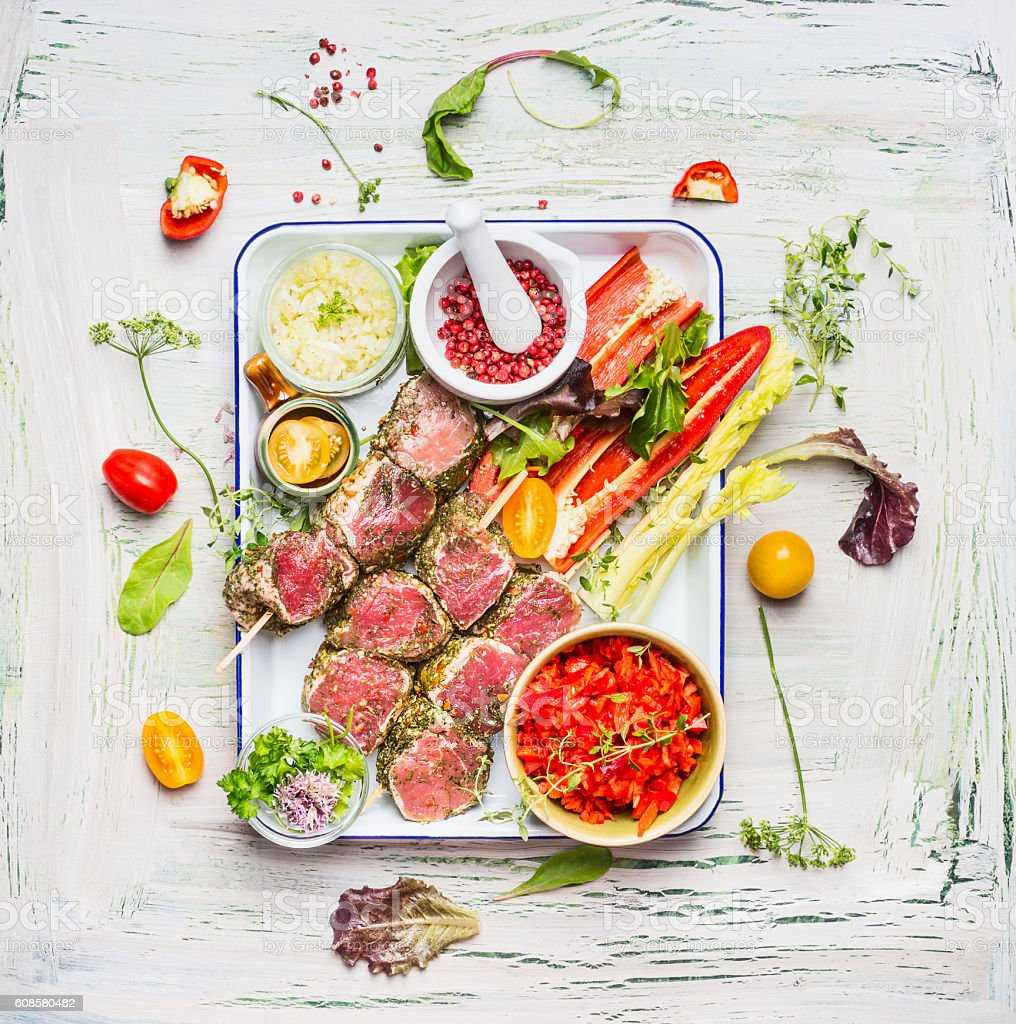 Meat skewers with fresh cutting vegetables and seasoning stock photo