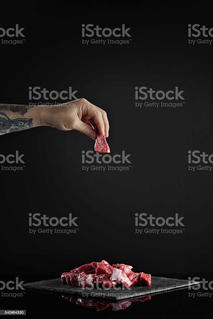 Meat slice isolated on black cooking set stock photo