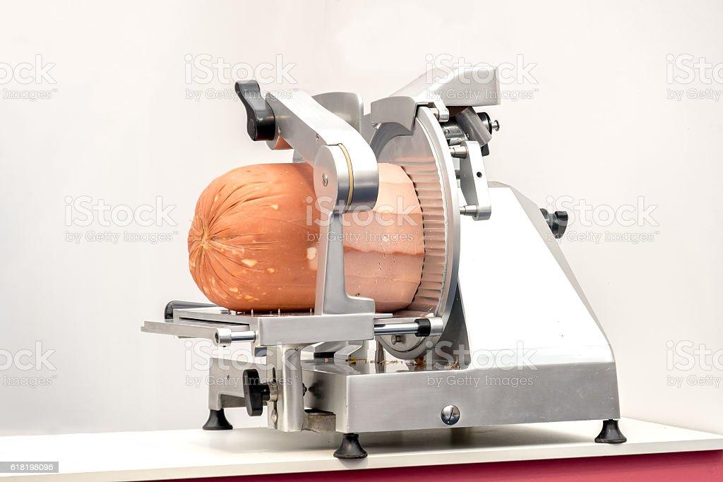 meat slicer mortadella stock photo