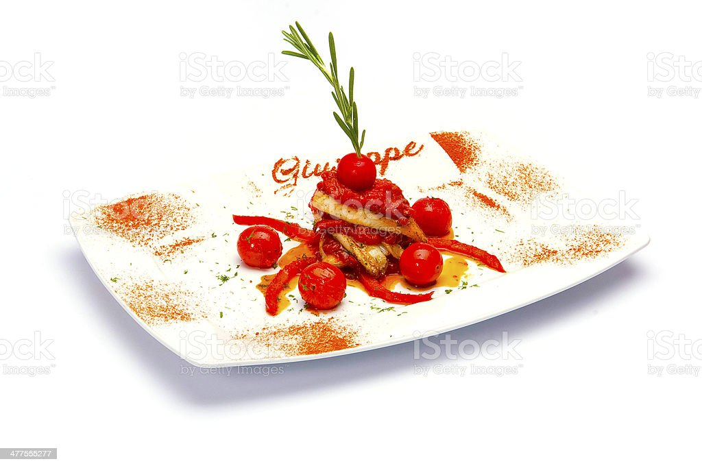 Meat slices cooked with pieces of quince royalty-free stock photo