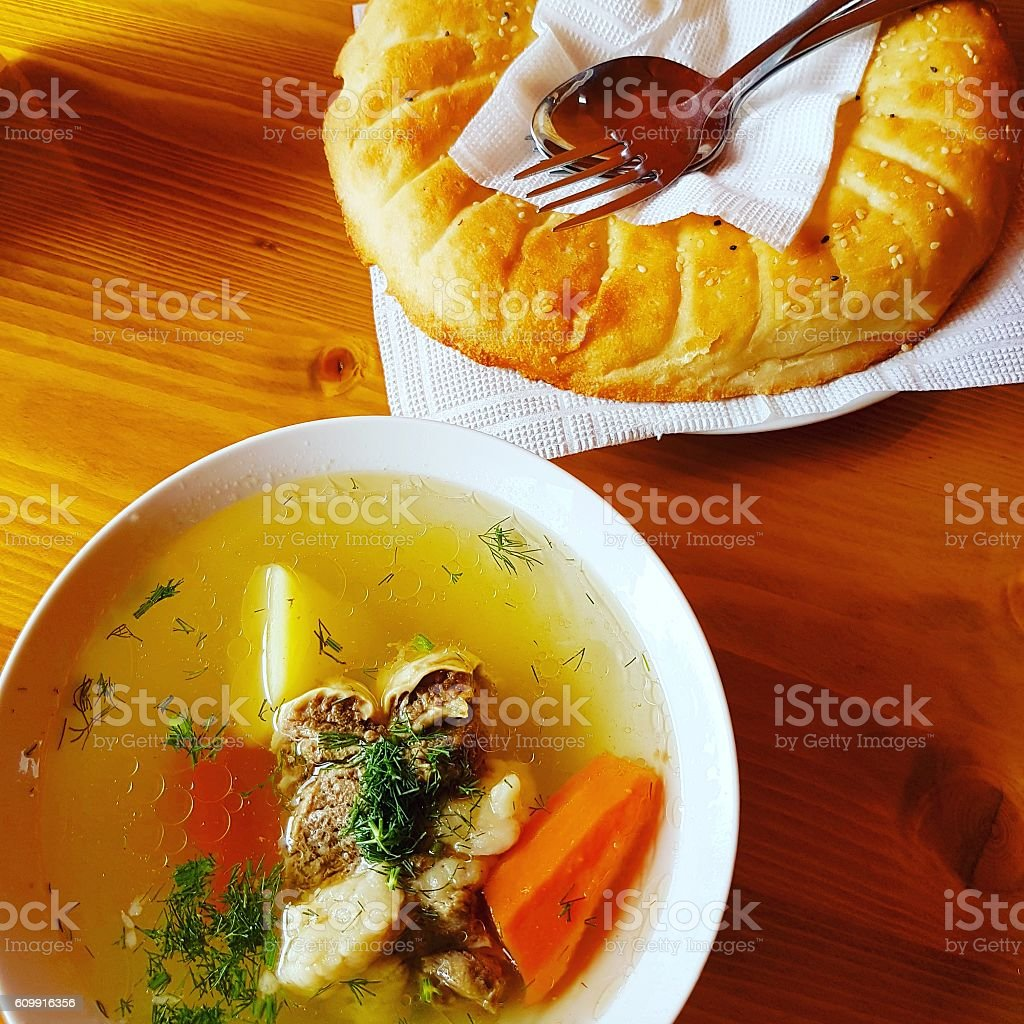 meat soup with flatbread stock photo