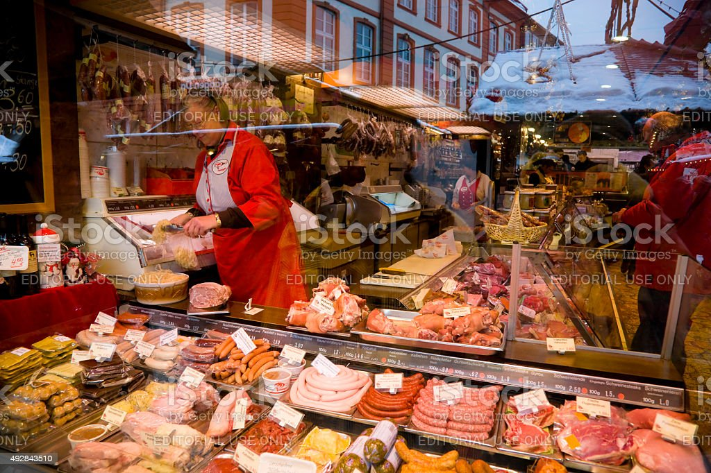 Meat stall at Christmas Market in Frankfurt, Germany stock photo