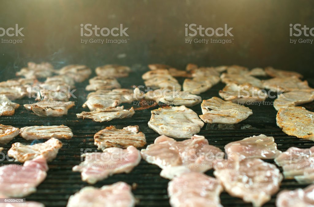 Meat steak barbecue on the grill outdoors. stock photo