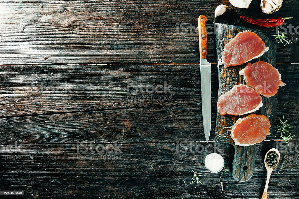 Meat steaks with spices stock photo