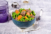Meat stew with peas and carrots