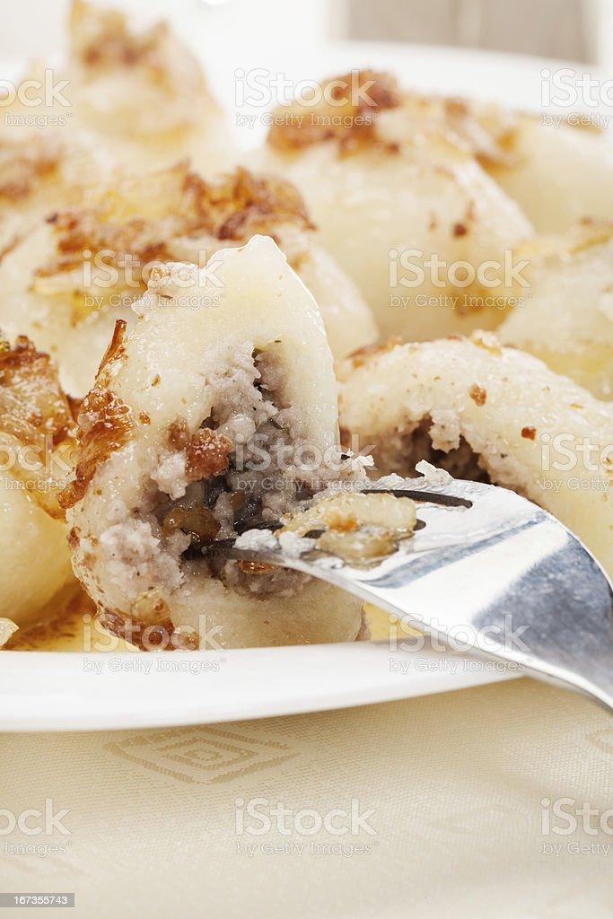 Meat stuffed dumplings with fried onion stock photo