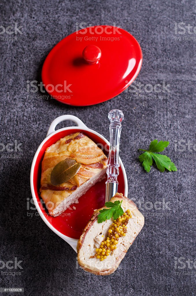 Meat terrine with bacon stock photo