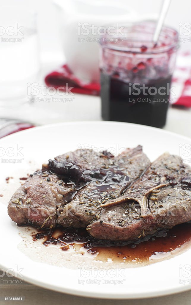 Meat with original cherry preserves sauce stock photo