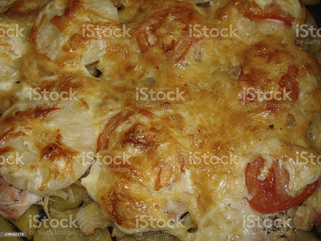 Meat with pineapple slices, potatoes and cheese royalty-free stock photo