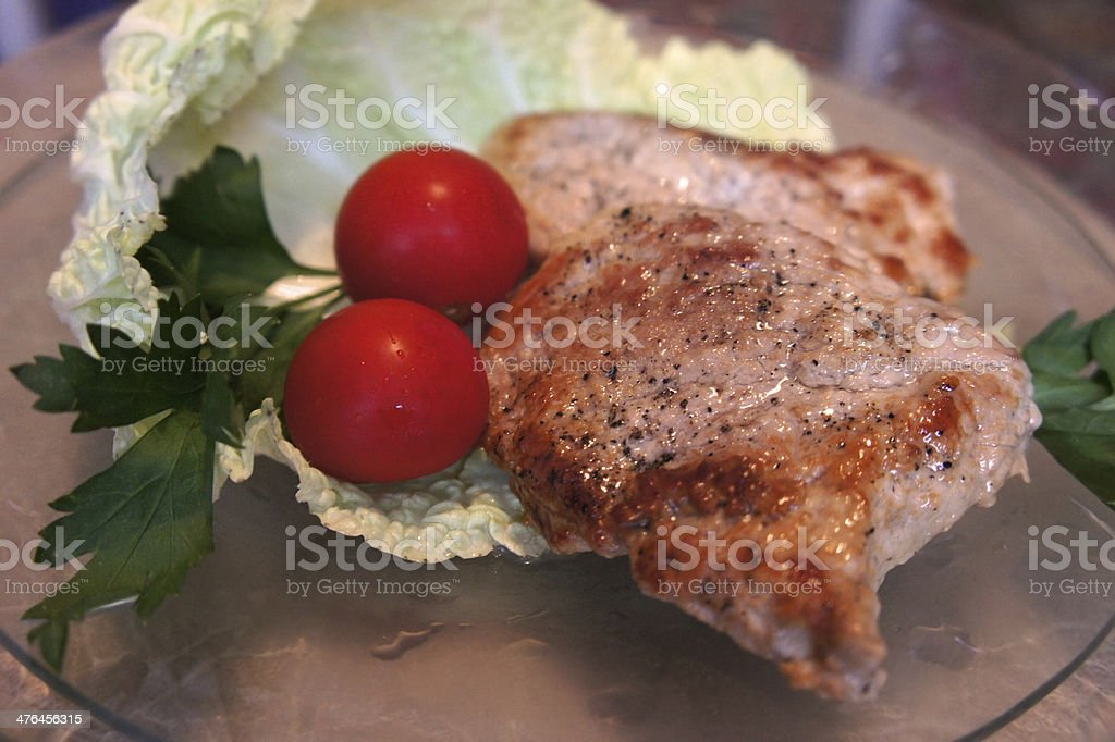 Meat with tomatoes royalty-free stock photo