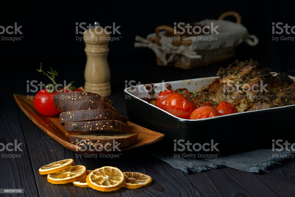 meat with vegetables cooked in the oven stock photo