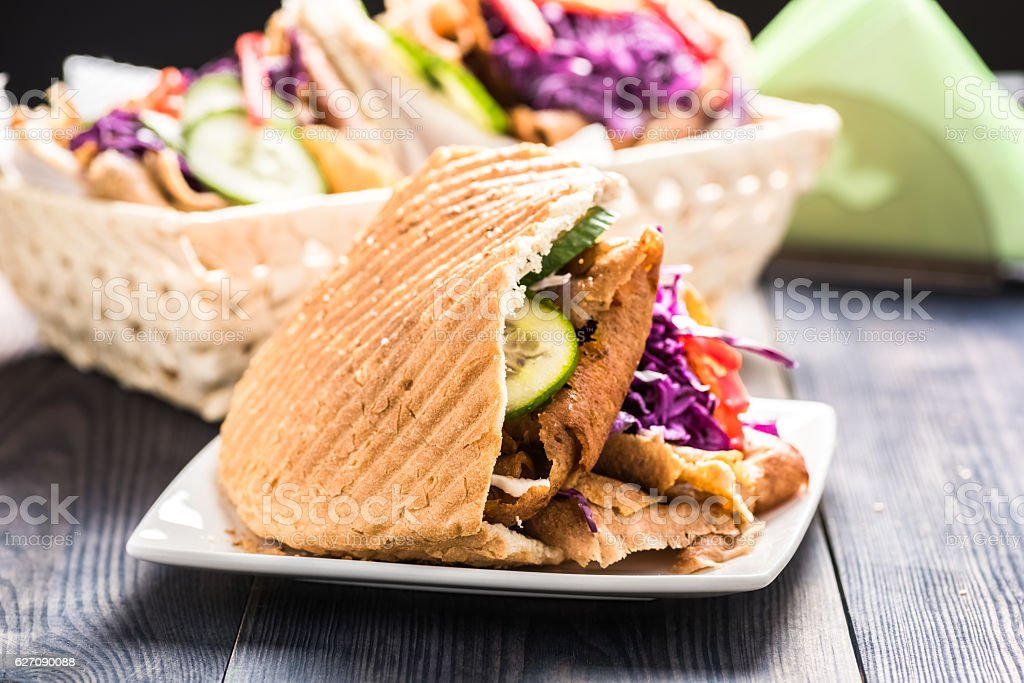 Meat with vegetables in pita bread roll stock photo