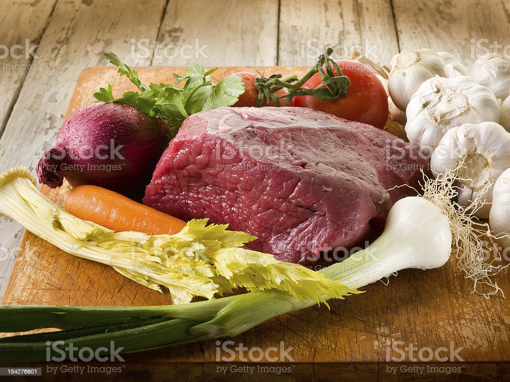meat with vegetables ingredients over cutting board royalty-free stock photo