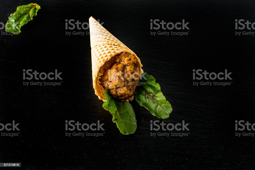 Meatball in a wafer cone stock photo