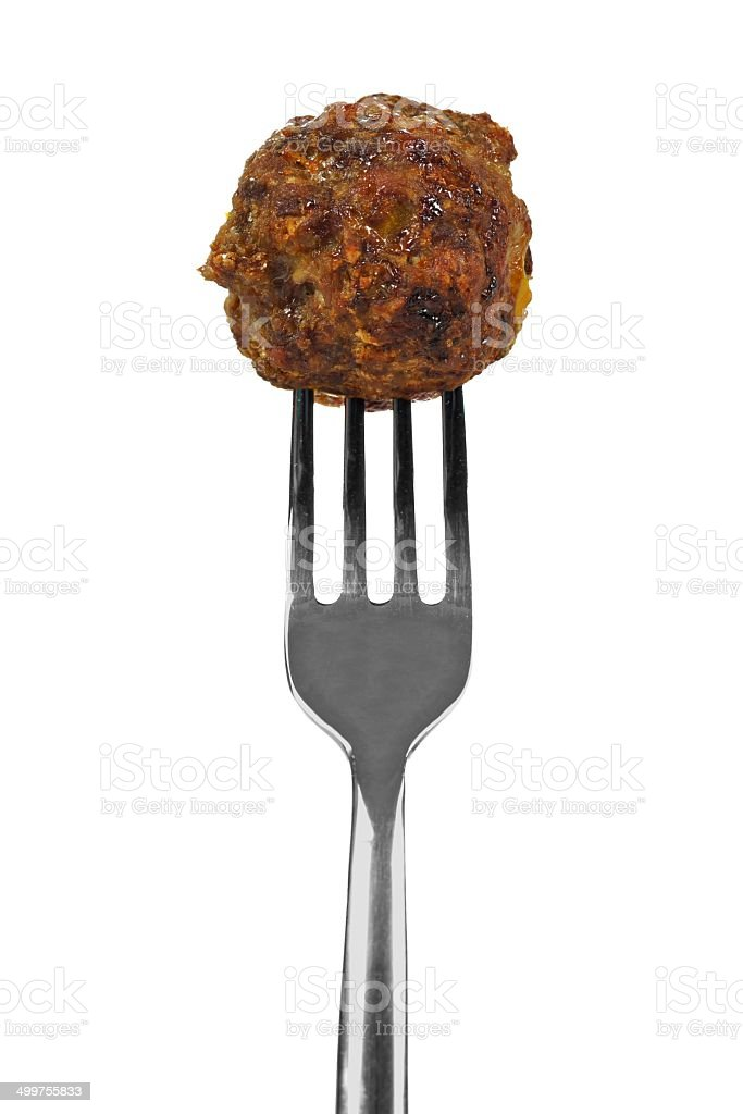 Meatball on fork over white stock photo