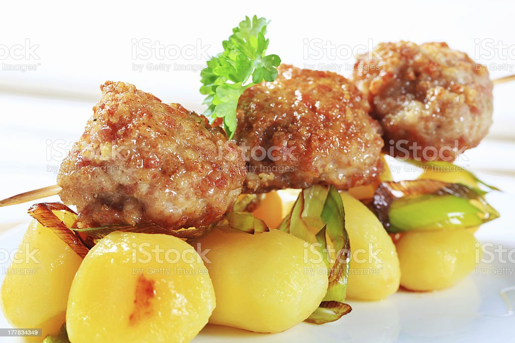 Meatball skewer and potatoes royalty-free stock photo