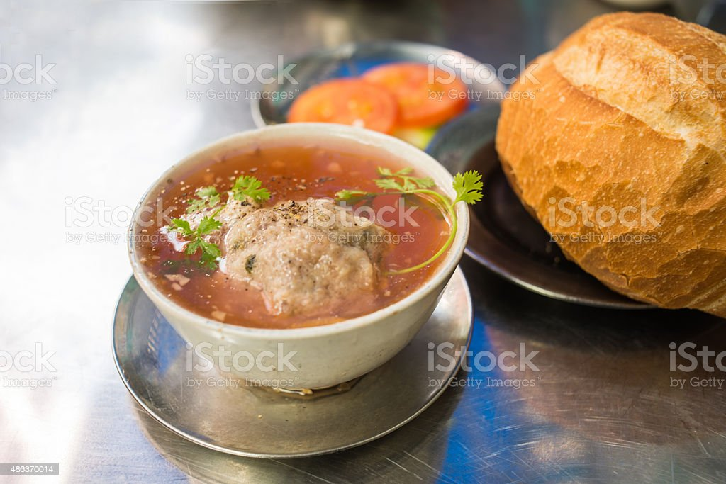 Meatball soup eat with bread and tomato stock photo