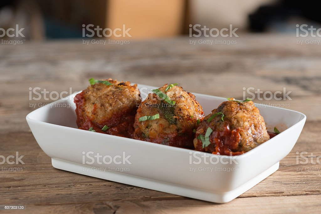 Meatball with tomato sauce in white plate. Selective focus. stock photo