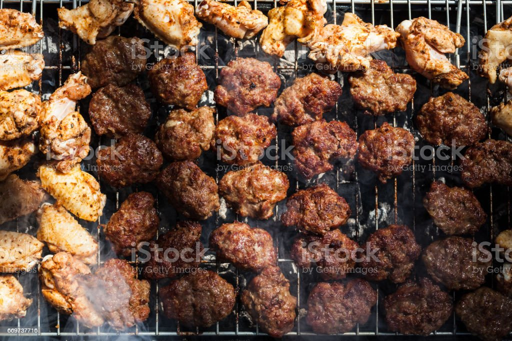 Meatballs And Chicken Nuggets On The Grill stock photo