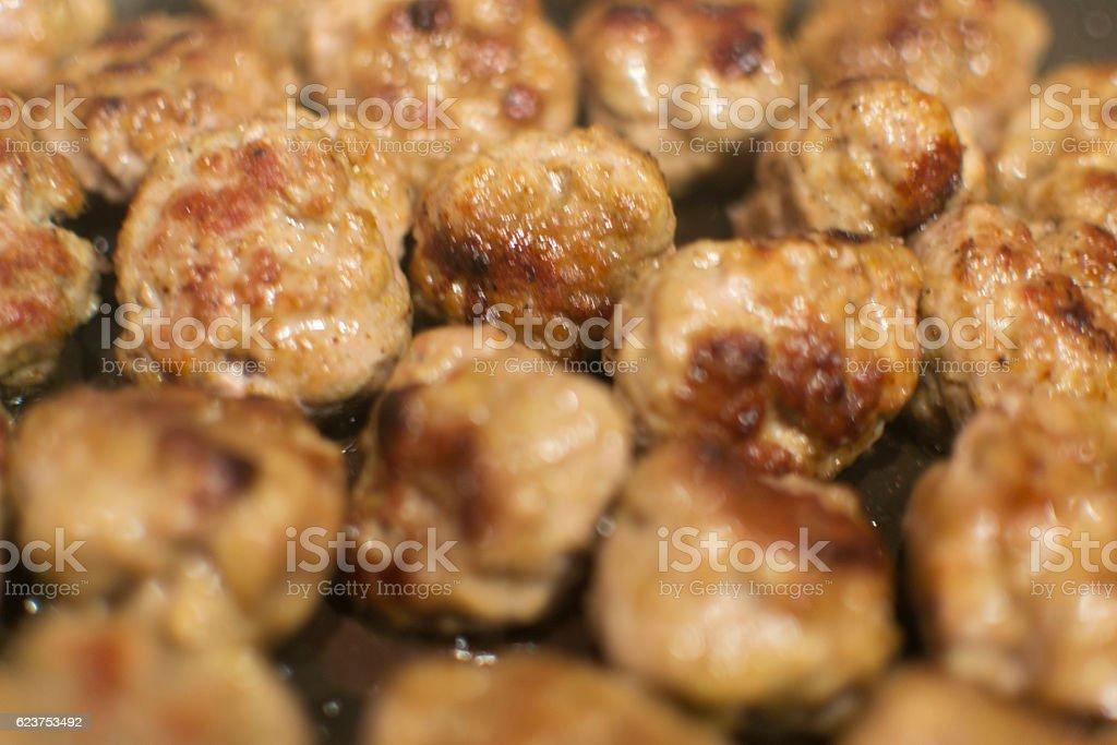 Meatballs frying stock photo