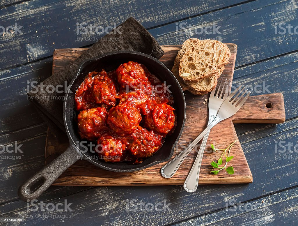 Meatballs in tomato sauce in a pan stock photo