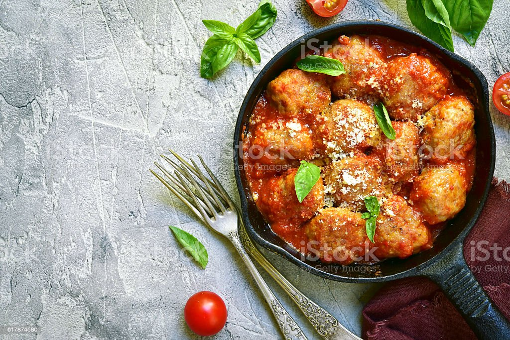 Meatballs in tomato sauce in a skillet.Top view. stock photo