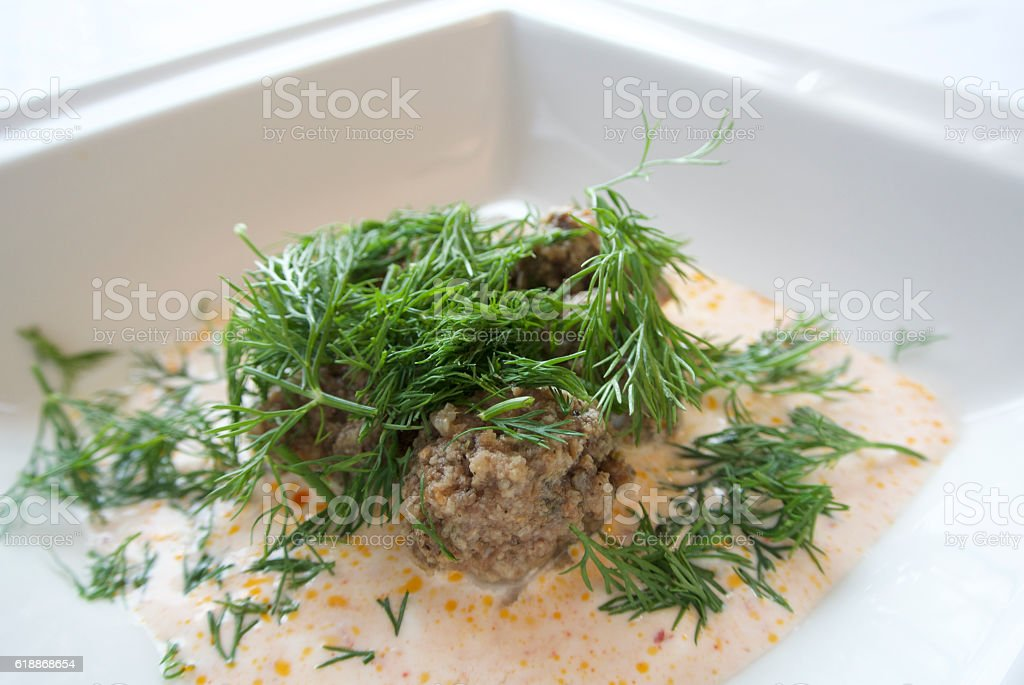 Meatballs in yoghurt sauce stock photo