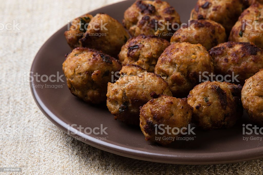 meatballs on brown plate stock photo