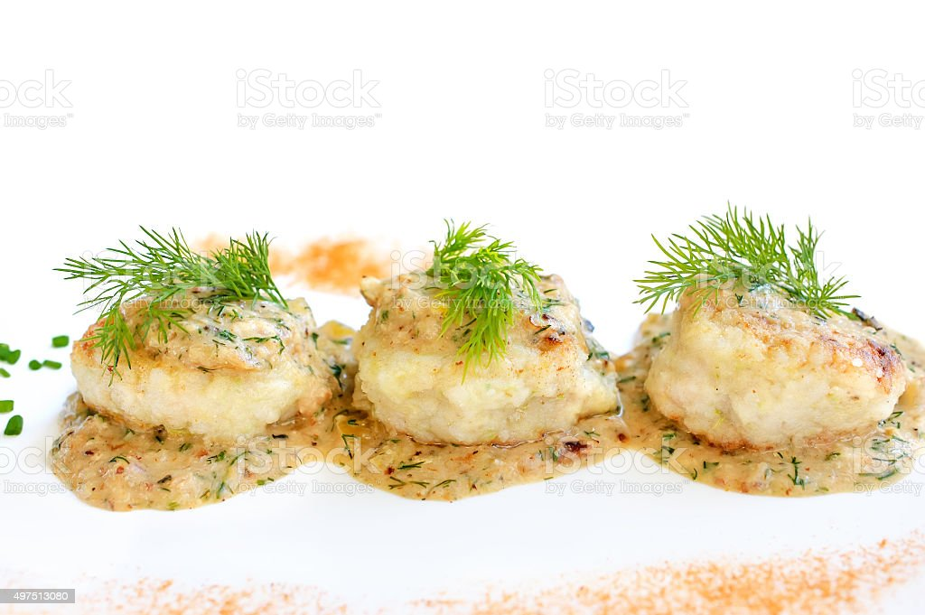 Meatballs served in a dill sauce on a white plate. stock photo