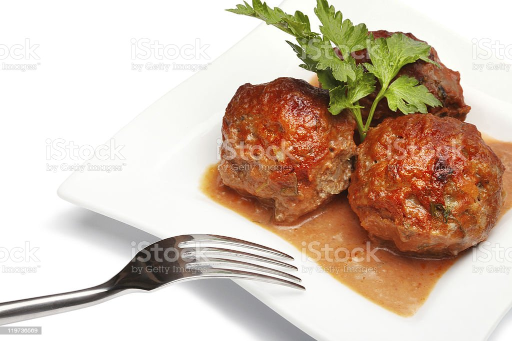 Meatballs served with parsley on a plate stock photo