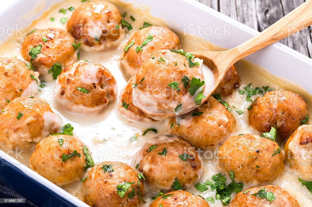 meatballs smothered in a creamy gravy sauce, close-up stock photo