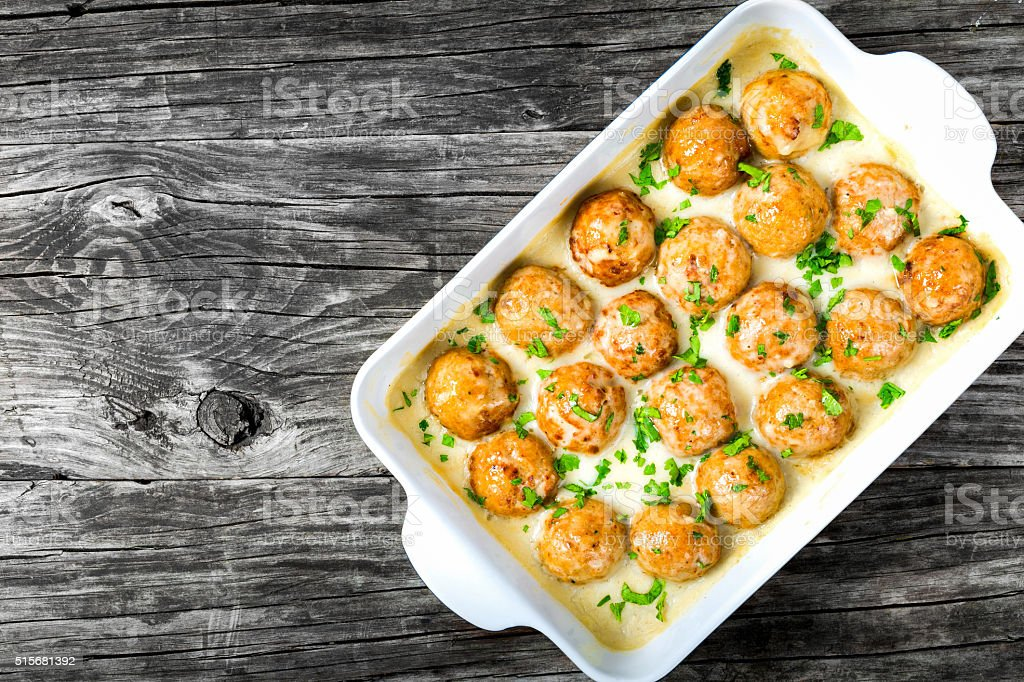 meatballs smothered in a creamy gravy sauce, top view stock photo