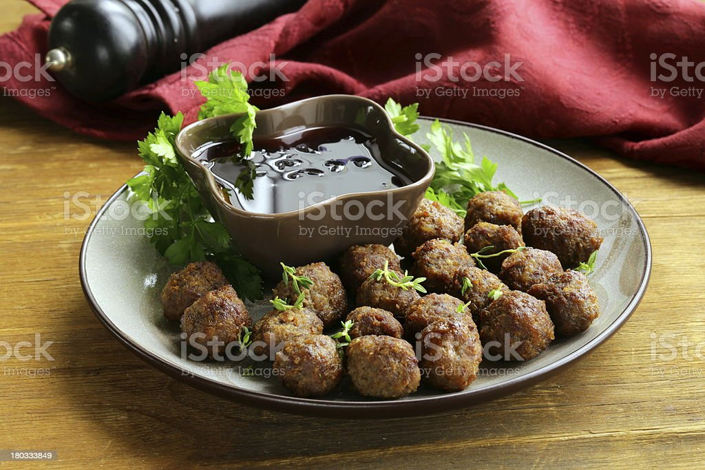 meatballs - traditional meat dish with sauce and herbs stock photo