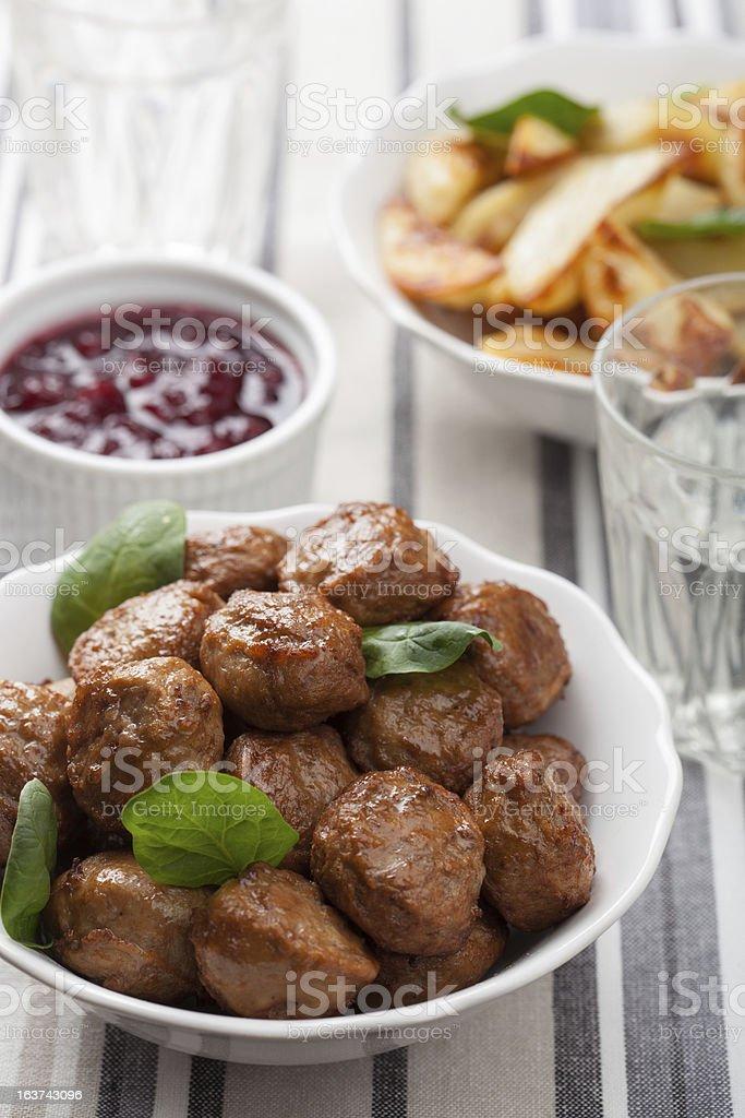 meatballs with potatoes and lingon jam stock photo