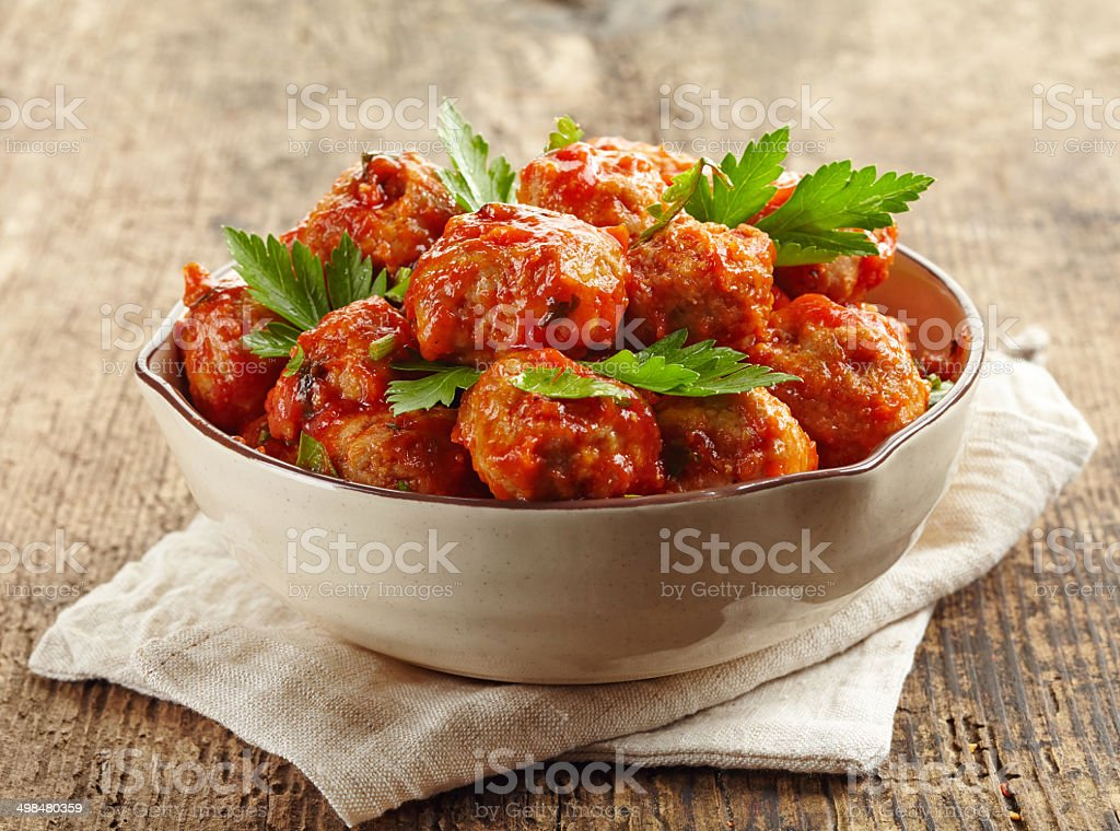 Meatballs with tomato sauce in a bowl stock photo