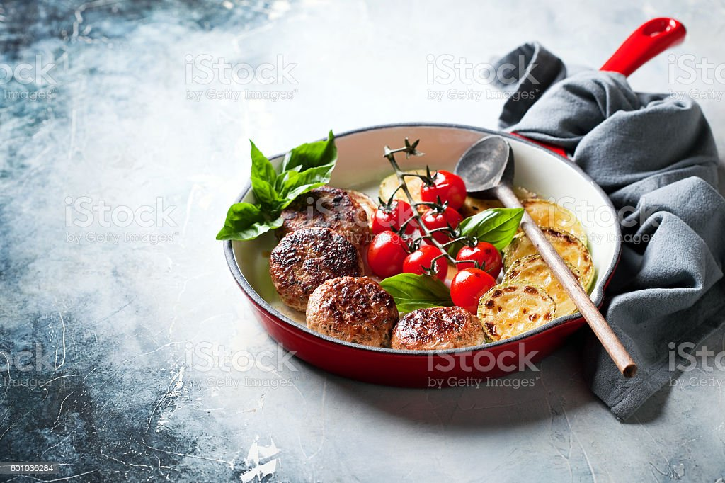 Meatballs with vegetables in cast iron skillet stock photo