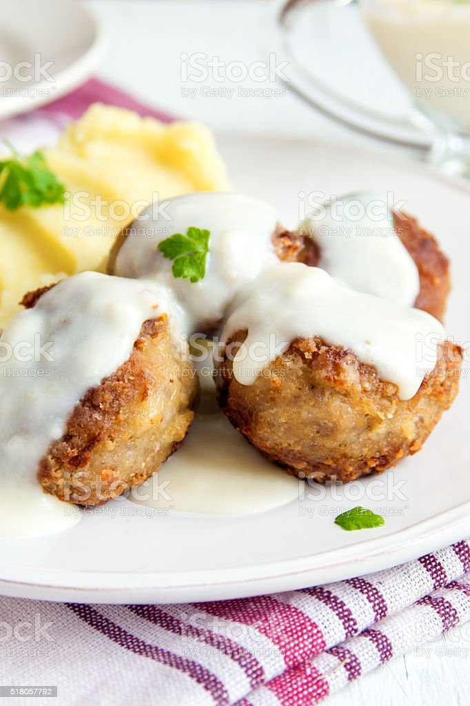 Meatballs with white creamy sauce stock photo