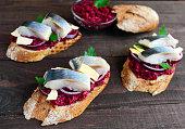 Meatless dietary sandwich: boiled beetroots, purple onion, salted herring
