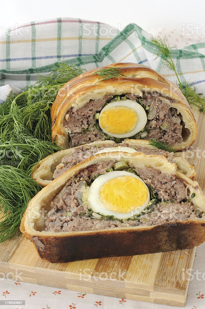 Meatloaf with egg and greens in the test royalty-free stock photo