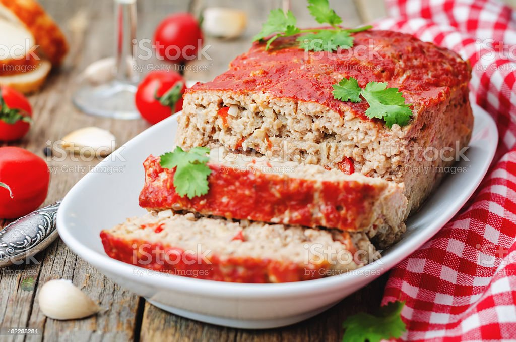 meatloaf with onion, pepper and garlic stock photo